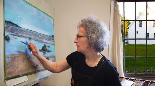 East Machias artist Jude Valentine works on &quotCampobello, Grand Manan and Lubec&quot in July at the Wadsworth Studio of the Heliker-LaHotan Foundation. This painting is one of three that position the county in the world looking out to the Atlantic Ocean and neighboring communities. It was installed on Oct. 5 at the Washington County Courthouse in Machias.