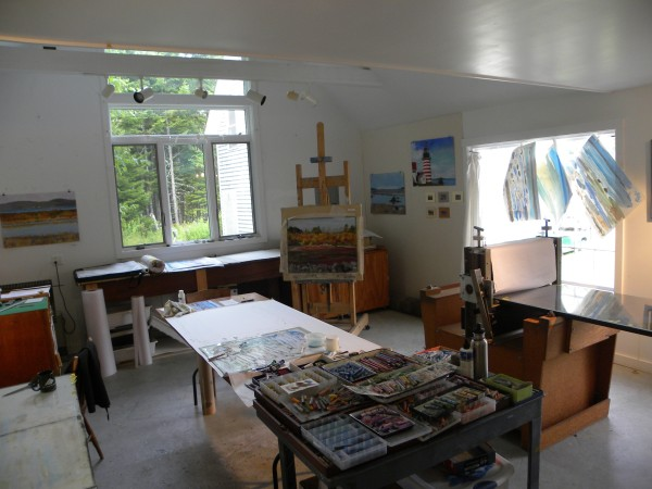 At the easel is the painting &quotBlueberrying,&quot and on the far right wall is the painting &quotWest Quoddy Headlight&quot as seen recently in Cranberry Isles. These are two of four paintings addressing Washington County's historic economic resources. The landscape on the far left wall is &quotView from Sipayik/Perry to St. Andrews, New Brunswick,&quot and the lower larger painting on the right wall is &quotCampobello, Grand Manan and Lubec.&quot All of these were installed on Oct. 5 at the Washington County Courthouse in Machias.