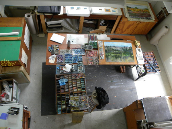 The painting &quotForestry&quot is being completed as part of the Washington County Courthouse commission seen recently in the Wadsworth Studio at the Heliker-LaHotan Foundation in Cranberry Isles. Smaller studies for larger works are on the table in the upper center of the photo, and the &quotBlueberrying&quot painting is in progress in the upper right.