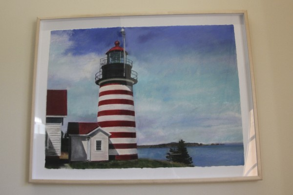 This painting by artist Jude Valentine, depicting the lighthouse in Lubec, is seen on Tuesday at the Washington County Courthouse in Machias.