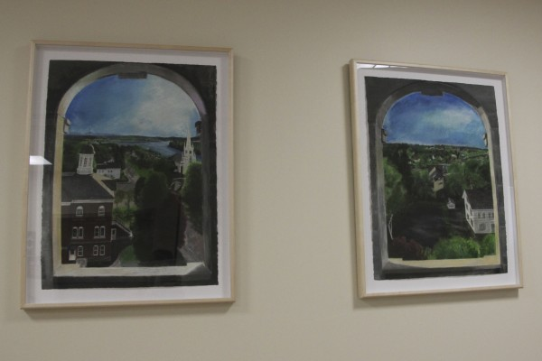 These two paintings by artist Jude Valentine, depicting the view from the belfry on top of the Washington County Courthouse, are seen Tuesday at the courthouse in Machias. Valentine did four views like this, one for each direction.