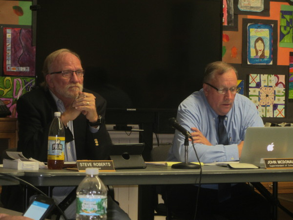 Regional School Unit 13 Superintendent John McDonald (right) unveils his Schools of the Future plan on Thursday night as school board Chairman Steve Roberts listens.