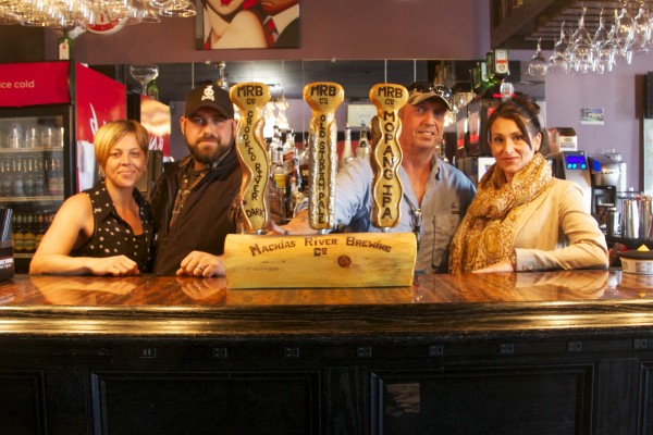 A prototype set of taps illustrates the three beers Matthew Gardner, second from left, hopes to be brewing soon on site at Skywalker's Bar and Grille. With him are his wife, Iyisa, and Skywalker's owners John and Danielle Parker.