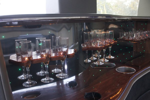 Glasses for a variety of beverages, which are just some of the amenities for passengers of Dean McGuire's limousine, can be seen Oct. 13 in Machias.