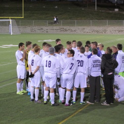 Coach Josh Stevens gathers his Hampden Academy team before the second half of Friday night's Class A North boys soccer game against Camden Hills at Hampden. The Broncos won 2-0.