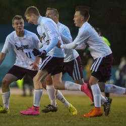 Ellsworth's Colby Clarke (center) celebrates with teammates after scoring a goal against Foxcroft Academy during their Northern Maine Class B soccer quarterfinal game on Wednesday in Ellsworth.