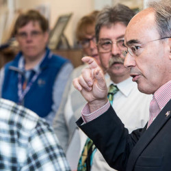 Rep. Bruce Poliquin asks questions of the staff at the Lewiston Vet Center during at a tour of the center on Tuesday in Lewiston. The tour follows concerns that the center did not have enough counselors on staff.