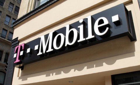 Signage for a T-Mobile store is pictured in downtown Los Angeles, California in this Aug. 31, 2011, file photo.