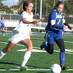 Belfast midfielder Alexis Racciopi (8) and Morse's Amanda Gagne run to the ball during a KVAC Class B high school game at Bath on Tuesday. The Shipbuilders tallied three second-half goals for a 4-2 win.