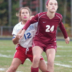 Mt. Ararat's Natalie Burch (left) battles for position with Bangor's Katie Butler during a high school soccer game at Topsham on Thursday. Bangor prevailed 3-0.