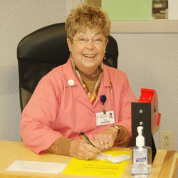 Sally Millhorn, president of the WCGH Aid, volunteers in Central Registration