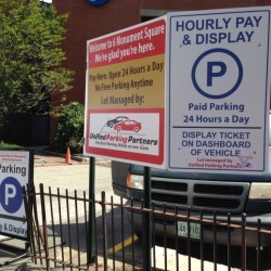 Portland city councilors will consider an ordinance to regulate companies that immobilize vehicles for parking violations at privately owned lots available for public use, like this one operated by Unified Parking Partners at Monument Square.