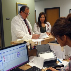 Ventzislav Vanguelov (L), an obstetrics and gynecology doctor, gives instructions to physician's assistant Celena Pollock (C) at Nuestra Clinica de Valle women's clinic in San Juan, Texas, September 22, 2015.