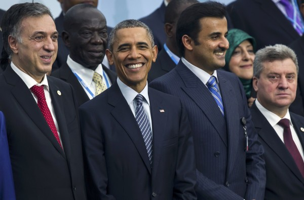 President Barack Obama (2nd left) stands among fellow world leaders as they pose for a photo during the opening day of the World Climate Change Conference 2015 at Le Bourget, near Paris, Nov. 30, 2015.