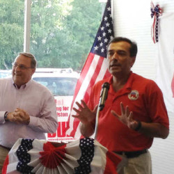 Maine Gov. Paul LePage (left) and Maine Republican Party Chairman Rick Bennett, shown here during a 2014 event at the party's Androscoggin County campaign headquarters, are leading an effort to gather the roughly 61,000 valid signatures needed to place the party's proposal for income tax cuts and welfare reform on the November 2016 state ballot.