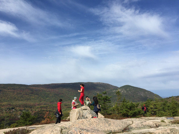 A group of students attending the annual Teens to Trails Acadia Fall Rendezvous on Columbus Day weekend pause to take in a view while hiking in Acadia National Park on Mount Desert Island. Students from nine Maine high school outing clubs gathered for the event.