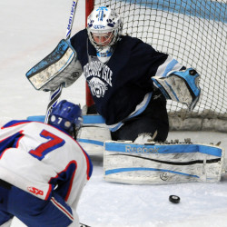 Presque Isle goalie Jillian Flynn stops a shot on goal by Messalonskee's Jacob Dexter during first-period action during the Class B East final at Alfond Arena in Orono in 2014.