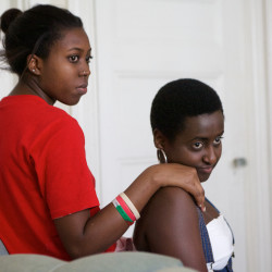 Burundian refugees Audrey Iradukunda, 20, (left) and Chanelle Irakoze, 19, talk with friends in Portland on June 20. Both hope to be doctors. Iradukunda just graduated from Portland High School and Irakoze is working three summer jobs after finishing her first year of college.