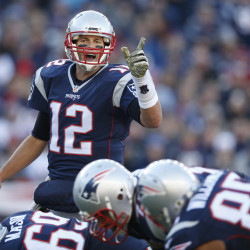 New England Patriots quarterback Tom Brady (12) makes an adjustment at the line of scrimmage during the second quarter of a recent game the Washington Redskins at Gillette Stadium.