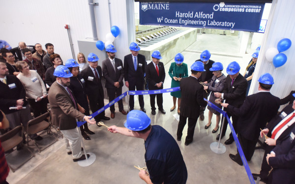 Dignitaries are handed scissors before the ribbon cutting for the new Harold Alfond W2 Ocean Engineering Laboratory Monday at the Advanced Structures and Composites Center at the University of Maine in Orono. The new laboratory will allow the testing of designs for offshore floating wind turbines, underwater turbines and ships in various wave and wind conditions.