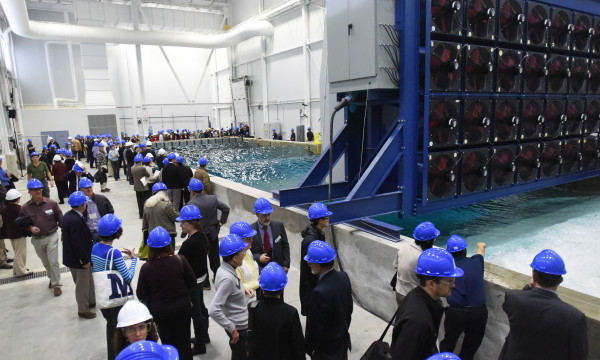 People observe a demonstration on Monday at the new Harold Alfond W2 Ocean Engineering Laboratory at the Advanced Structures and Composites Center at the University of Maine in Orono. The new laboratory will allow the testing of designs for offshore floating wind turbines, underwater turbines and ships in various wave and wind conditions.