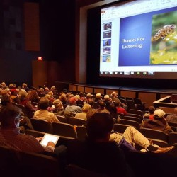 Mike Palmer speaks during the 2015 Maine State Beekeepers Association annual meeting and conference recently at Hampden Academy.