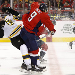 Washington defenseman Dmitry Orlov (9) checks Boston's Matt Beleskey (39) in the second period of Thursday night's game at Verizon Center in Washington, D.C. The Capitals won 4-1.
