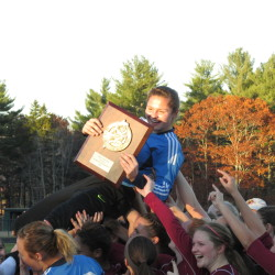 Bangor High School goalkeeper Emily Gilmore is hoisted onto her teammates' shoulders holding the Class A North soccer championship plaque after the Rams edged Camden Hills 3-2 on Wednesday.