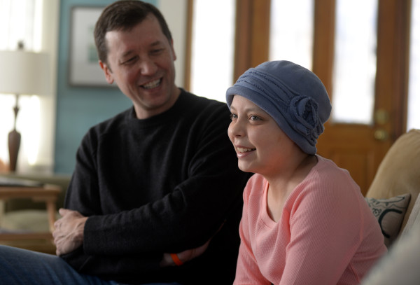 Katherine Bowen, 13, along with her father, Stephen Bowen, talk about how Katherine is able to communicate with her classes through a laptop computer on her end and a VGo robot at the school, despite ongoing cancer treatments,