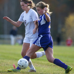 Orono's Aashild Fridtun (left) and Bucksport's Makenzie Smith battle for the ball during their Class C North girls soccer championship game at Orono Wednesday.