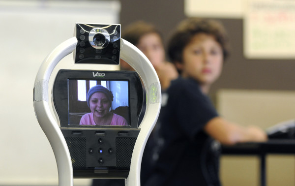 Katherine Bowen, 13, attends her math class at Camden-Rockport Middle School through the use of a VGo robot, which she controls from a laptop either at home or in the hospital while receiving treatments for leukemia.