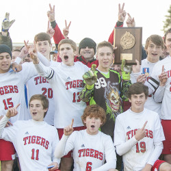 Members of the Fort Fairfield Tigers celebrate with the Class D North trophy after beating Bangor Christian 2-1 in overtime in the final Wednesday at Fort Fairfield.
