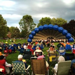 "The Bangor Band performs under their blue ""Clamphitheatre"" band shell."