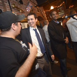 Lewiston mayoral candidate Ben Chin greets supporters at She Doesn't Like Guthries in Lewiston on Nov. 3 after learning there will be a run-off election between Chin and current Lewiston mayor Robert Macdonald in December.