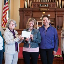 The Broad Bay Congregational United Church of Christ presents a check for $4,219.47 to New Hope for Women. Pictured left to right: Rev. Nancy Duncan, Pastor of the Broad Bay Church; Claire Riser, Co-moderator of Broad Bay Church; Susanna Norwood-Burns of NHFW; Karen Lilli Pax, soprano; and Kristi Braun of NHFW.