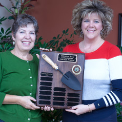 Lisa Colburn (left), chairperson of the Orono Beautification Committee, presents the 2015 Garden Trowel Award to Tracey Whitten, owner of the University Inn for its winning entry in the Window Box and Container Contest.