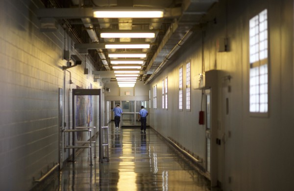 Inmates walk the hallways during a media tour of the Curran-Fromhold Correctional Facility in Philadelphia, Pennsylvania, August 7, 2015.