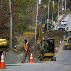 Crews work on roads on the Bennoch Road in Orono, Oct. 30, 2013.