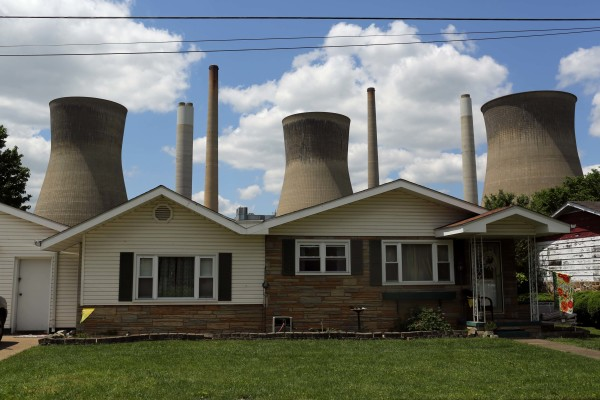 The John Amos coal-fired power plant is seen behind a home in Poca, West Virginia. May 18, 2014.