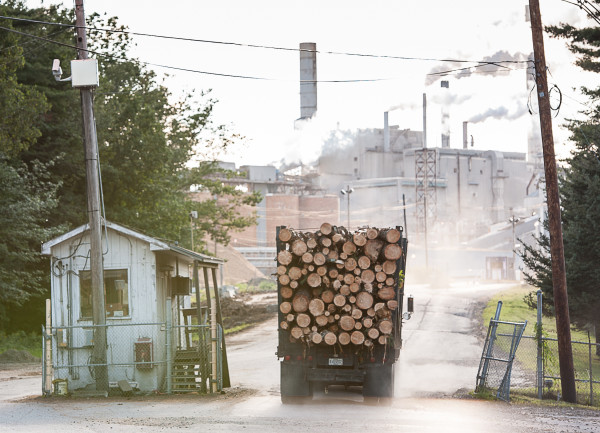 A logging truck delivers logs to the Verso paper mill in Jay.