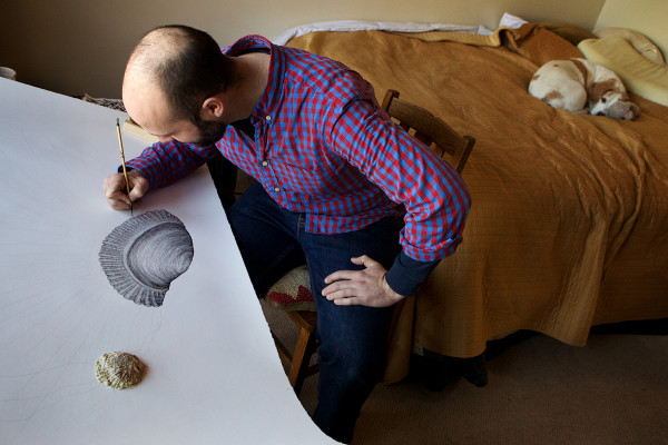With his dog, Daisy, curled up nearby, Portland artist Aaron Staples paints a detailed picture of an oyster by the window in a spare bedroom at his house just off Congress Street. The international environmental organization Greenpeace recently tapped Staples to make art for their yearlong &quotNot Just Tuna&quot campaign.