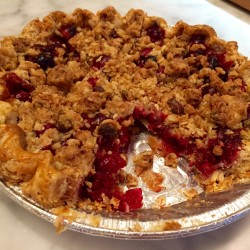 The cranberry pie, topped with pistachios and oats, at Tandem Coffee + Bakery is a new New England classic.