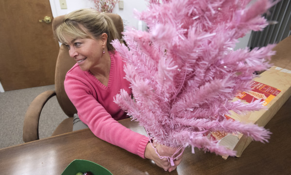 Bangor High School math teacher Catherine Gordon was asked to take down a 32-inch-tall pink plastic Christmas tree that was on display in her classroom. She has now received approval to put the tree back up.