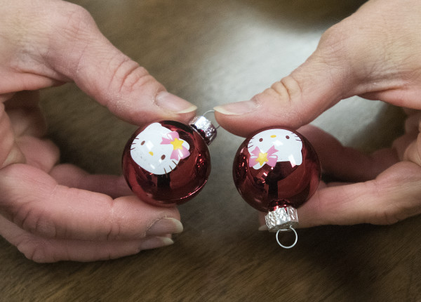 Bangor High School math teacher Catherine Gordon shows ornaments that were on a small, pink Christmas tree on display in her classroom.