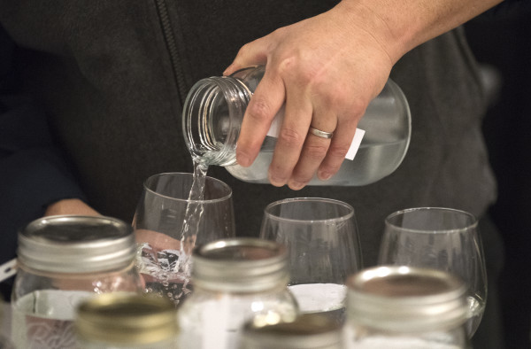 Samples of water are poured for the judges during the Maine Rural Water Association's annual meeting in Bangor on Thursday.