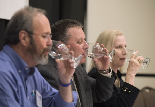 Judges (from left) Andrews Tolman, Mike Thibodeau and Virginia Manuel taste water samples during the Maine Rural Water Association's annual meeting in Bangor on Thursday. The judges tried 10 samples in two categories.