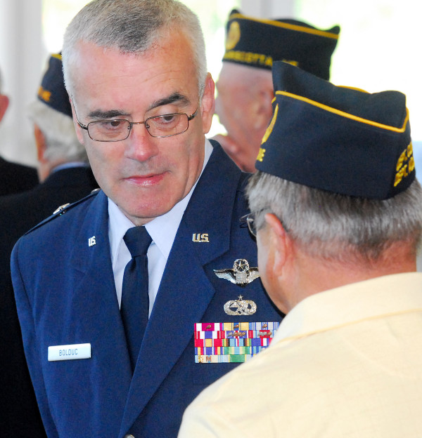 Brig. Gen. Gerard Bolduc is greeted by legion members at the American Legion Conference.