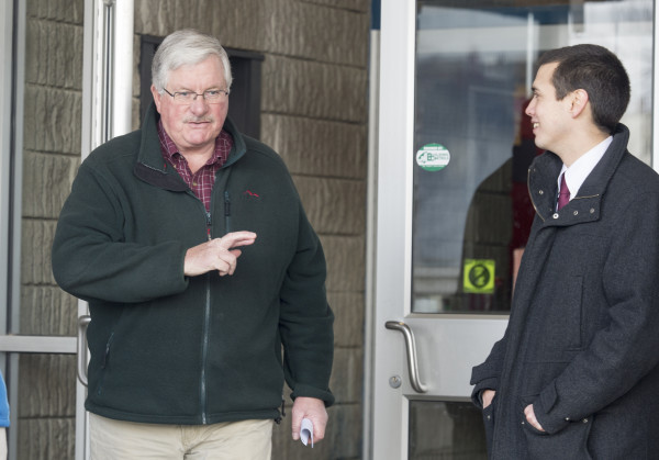 &quotFingers crossed,&quot said Stephen MacDougall (left) to Lewiston mayoral candidate Ben Chin as he left Longley Elementary School on Tuesday after voting in the special run-off election between Chin and current Lewiston Mayor Robert Macdonald.