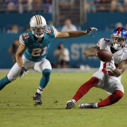 Giants edge Dolphins on Manning-Cruz TD pass
