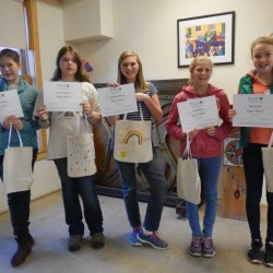 Newly trained 4-H Super Sitters display their certificates.